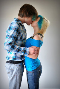 Teens kissing